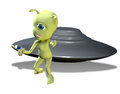 Invading green alien a one eyed with a ray gun stand in front of a flying saucer Stock Photo