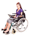 Invalid student girl on wheelchair with laptop Royalty Free Stock Photo