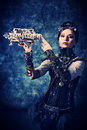 Invention portrait of a beautiful steampunk woman over grunge background Stock Photos