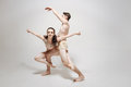 Inventive young dancers performing in the white colored studio Royalty Free Stock Photo