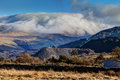 Inversion clouds hugging tops mountains snowdonia national park north wales Royalty Free Stock Photos
