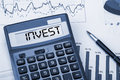 Invest displayed on calculator Royalty Free Stock Photo