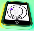 Invest smartphone shows investors and investing money online showing Royalty Free Stock Photos
