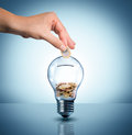 Invest to energy concept euro in bulb piggybank Stock Photo