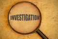 Investigation magnifying glass focused on Royalty Free Stock Photography