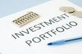 Investment portfolio documents on blue background Stock Photography