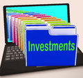 Investments folders laptop show financing investor and returns showing Stock Images