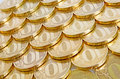 Investments shiny yellow coins orderly arranged on the plane Royalty Free Stock Photography