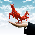 Investor carry red horse on cloud animal farm business concept give the to running Stock Images