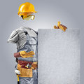 Invisible builder shows information poster construction worker on grey background Royalty Free Stock Photos