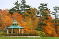 Inviting gazebo in park with nice view to the forest Stock Images