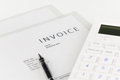 Invoice in clear folder and white calculator Stock Image