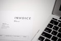 Invoice close up of and laptop computer Royalty Free Stock Photo