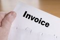 Invoice hand holding letter with opened envelope Royalty Free Stock Photo