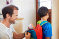 Involved dad school lunch father packing into son backpack before he goes to learn Royalty Free Stock Image