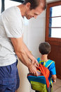 Involved dad school lunch father packing into son backpack before he goes to learn Royalty Free Stock Photography
