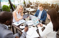 Involved professional colleagues sitting at the table working atmosphere pleasant diligent and being in work Royalty Free Stock Photo