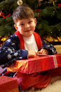 InYoung Boy Opening Christmas Presents Stock Photography