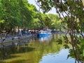 Ioannina  city beside the lake pamvotis, in summer season, platanus trees lake boats , greece Royalty Free Stock Photo