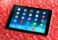 Ipad air london uk – december th the new on christmas background is the fifth generation tablet computer designed Royalty Free Stock Images