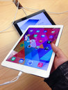 Ipad air toronto november custormer holds an at the apple store in toronto canada on november apple s newest goes on sale Royalty Free Stock Photo