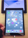 Ipad air toronto november custormer tries the at the apple store in toronto canada on november Royalty Free Stock Image