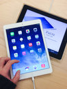 Ipad air toronto november custormer tries the at the apple store in toronto canada on november Royalty Free Stock Photography