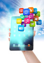 Ipad mini app explosion in the hand a woman is holding a various apps use it for a communication concept Royalty Free Stock Image
