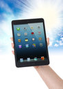 Ipad mini on hand clipping path for maximum size Royalty Free Stock Image