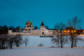 Ipatiev monastery in kostroma russia at night the male famous landmark of the golden ring tour river covered with ice and snow and Stock Image