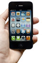 Iphone 4s in hand Royalty Free Stock Photos
