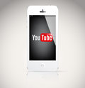 Iphone 5 device, showing the YouTube logo. Royalty Free Stock Photos