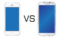 Iphone 5 white vs Samsung Galaxy S4 white Royalty Free Stock Photos
