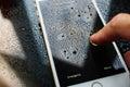 IPhone 7 Plus waterproof unlocking iphone under rain Royalty Free Stock Photo