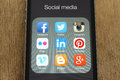 Iphone with popular social media icons on its screen on wooden background kiev ukraine june Royalty Free Stock Photos
