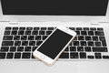 IPhone 5s Gold on silver laptop Royalty Free Stock Photo
