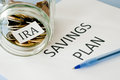 Ira savings plan document and coin jar Royalty Free Stock Photo