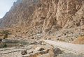 Iranian tourists walk past the mountain range in beautiful persian valley Royalty Free Stock Photo