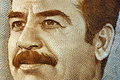 Iraqi money a close up of saddam hussein s face on an dinar Stock Images