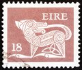 IRELAND - CIRCA 1981: A stamp printed in Ireland shows a dog from an ancient artwork, circa 1981. Royalty Free Stock Photo