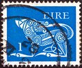IRELAND - CIRCA 1971: A stamp printed in Ireland shows a dog from an ancient artwork, circa 1971. Royalty Free Stock Photo