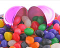 Iridescent Easter egg and jelly beans Royalty Free Stock Images