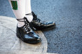 Irish bagpipes player shoes close up shot of the feet and of a traditional bagpipe wearing traditional guillie brogues oxford Royalty Free Stock Images