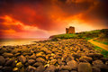 Irish castle abandoned medieval on ireland dingle coast under dramatic sunset Royalty Free Stock Photos