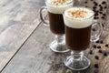 Irish coffee in glass on wood