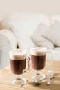 Irish coffee two coffees on table in living room Stock Photos