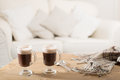 Irish coffee two coffees on table with winter scarf Royalty Free Stock Photos