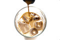 Irish cream on the rocks with ice cubes Royalty Free Stock Image