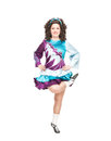 Irish dancer dancing isolated young woman in dance dress and wig Royalty Free Stock Photography