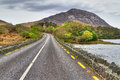 Irish road with mountain view Royalty Free Stock Photography